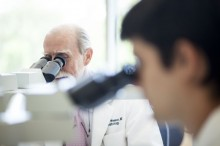 Photo of doctors looking through microscopes